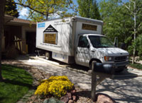 Bestway Insulation Box Truck with Signs Parked in Driveway with yellow flowers